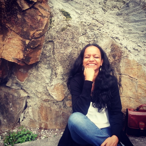 Malini Parker laughing at herself